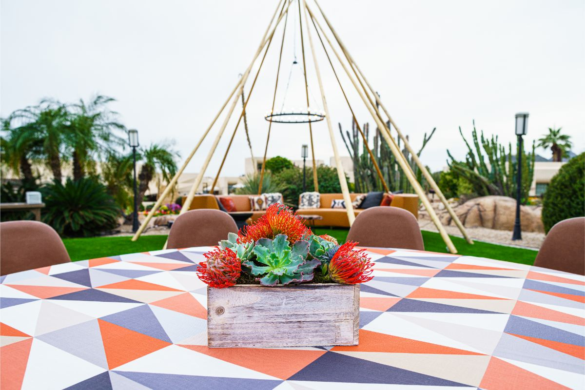 Elegant, outdoor southwest corporate event in Phoenix with bright linens, beautiful succulent and desert florals and an extravagant open decorative teepee.